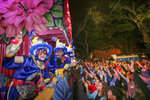 The Mystic Krewe of Nyx parade makes its way through the streets during Mardi Gras celebrations in New Orleans, Wednesday, Feb. 19, 2020. (AP Photo/Brett Duke)