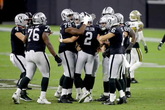 Las Vegas Raiders players celebrate after kicker Daniel Carlson (2) scored a 54 yard field goal against the New Orleans Saints during the second half of an NFL football game, Monday, Sept. 21, 2020, in Las Vegas. (AP Photo/Isaac Brekken)