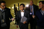 University of Maryland president Wallace Loh, center, leaves after speaking at a House of Delegates appropriations committee hearing, Thursday, Nov. 15, 2018, in Annapolis, Md. The hearing was called to examine how the university and University System of Maryland's Board of Regents responded to the death of football player Jordan McNair. (AP Photo/Patrick Semansky)