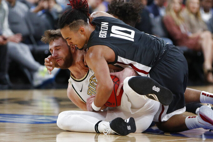 Colorado's Lucas Siewert, left, and Washington State's Isaac Bonton scramble for the ball during the first half of an NCAA college basketball game in the first round of the Pac-12 men's tournament Wednesday, March 11, 2020, in Las Vegas. (AP Photo/John Locher)