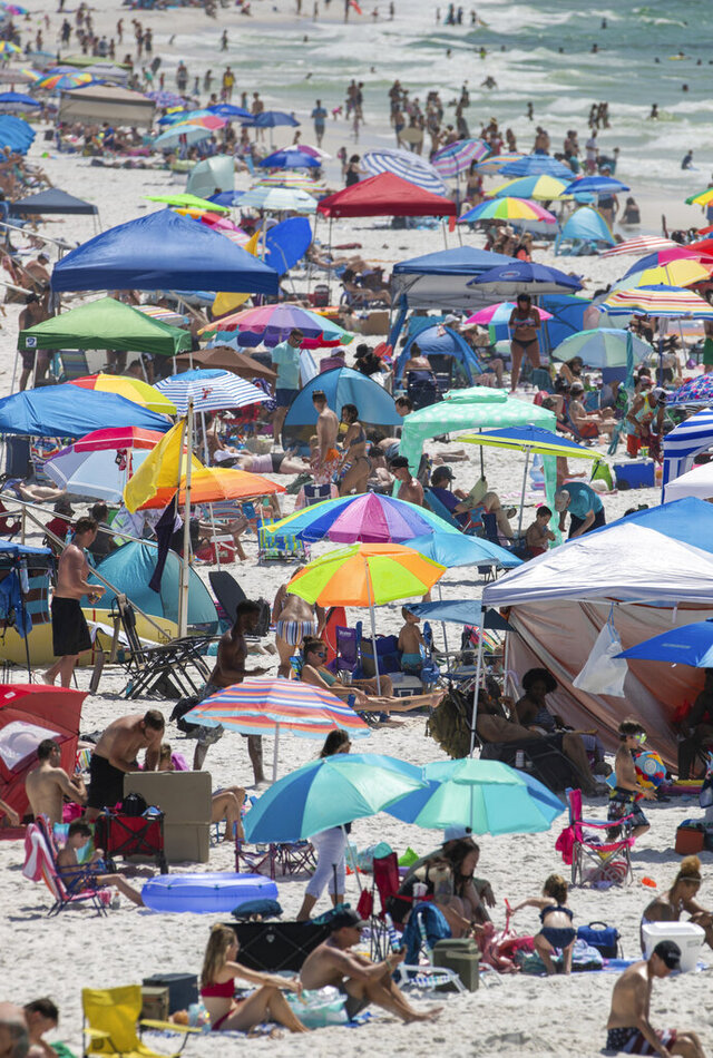 People visit Pensacola Beach in Pensacola, Fla., Saturday, May 23, 2020, during the coronavirus pandemic. (David Grunfeld/The Advocate via AP)