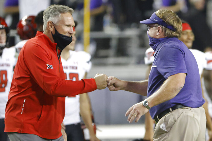 Texas Tech head coach Matt Wells and TCU head coach Gary Patterson bump fists following an NCAA college football game Saturday, Nov. 7, 2020, in Fort Worth, Texas. TCU won 34-18. (AP Photo/Ron Jenkins)