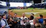 Miami Marlins baseball team CEO Derek Jeter, center, speaks to members of the media inside Marlins Park stadium, Monday, Feb. 11, 2019, in Miami. Jeter is entering his second season as CEO of the Marlins, who remain in the throes of a rebuilding project. (AP Photo/Wilfredo Lee)