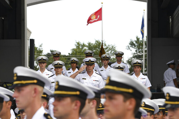 A member of the Brigade of Midshipmen salutes during pre-game ceremonies before an NCAA college football game between Navy and Air Force, Saturday, Sept. 11, 2021, in Annapolis, Md. (AP Photo/Terrance Williams)