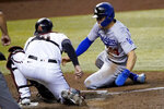 Los Angeles Dodgers' Enrique Hernandez, right, is tagged out trying to steal home by Arizona Diamondbacks catcher Carson Kelly during the sixth inning of a baseball game against the Arizona Diamondbacks, Thursday, Sept. 10, 2020, in Phoenix. (AP Photo/Matt York)