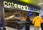Damage is seen inside Cat Cora's Kitchen at Hartsfield-Jackson Atlanta International Airport, Thursday, Feb. 13, 2020, in Atlanta, after part of the restaurant's ceiling collapsed. (Sue Nadeau via AP)