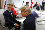 French President Emmanuel Macron, left, U.S. President Donald Trump with Britain's Prime Minister Boris Johnson, right, and Canadian Prime Minister Justin Trudeau attend a G7 working session on