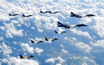 "FILE - In this Sept. 18, 2017, file photo provided by South Korea Defense Ministry, U.S. Air Force B-1B bombers, F-35B stealth fighter jets and South Korean F-15K fighter jets fly over the Korean Peninsula during a joint drills. U.S. President Donald Trump promised to end ""war games"" with South Korea, calling them provocative, after meeting North Korean leader Kim Jong Un on June 12, 2018. His announcement appeared to catch both South Korea and the Pentagon by surprise. (South Korea Defense Ministry via AP, File)"