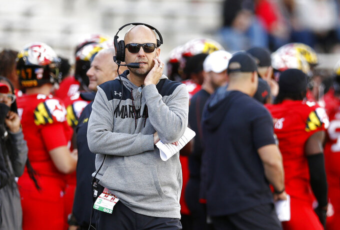 Maryland interim head coach Matt Canada walks on the sideline in the second half of an NCAA college football game against Rutgers, Saturday, Oct. 13, 2018, in College Park, Md. (AP Photo/Patrick Semansky)