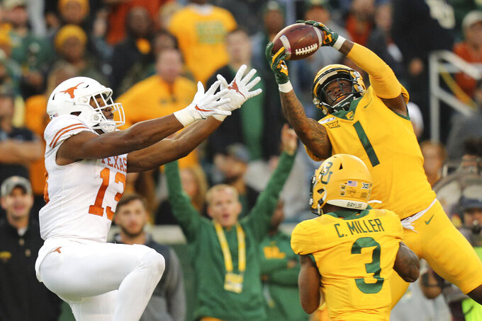 Baylor cornerback Grayland Arnold (1) intercepts a pass intended for Texas wide receiver Brennan Eagles (13) in the third quarter of an NCAA college football game Saturday, Nov. 23, 2019, in Waco, Texas. (AP Photo/Richard W. Rodriguez)