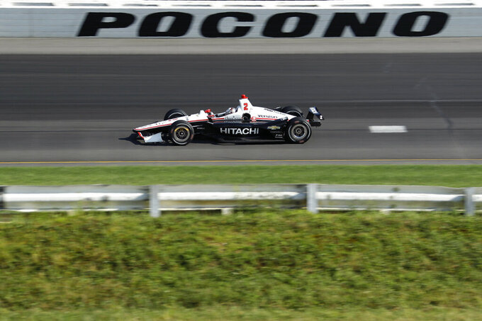 Josef Newgarden drives into Turn 1 during an IndyCar Series auto race at Pocono Raceway, Sunday, Aug. 18, 2019, in Long Pond, Pa. (AP Photo/Matt Slocum)