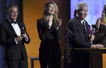 Director David Lynch accepts his honorary award as Kyle MacLachlan, from left, and Laura Dern look on at the Governors Awards on Sunday, Oct. 27, 2019, at the Dolby Ballroom in Los Angeles. (Photo by Chris Pizzello/Invision/AP)