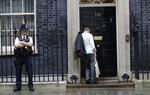 Dominic Cummings, political adviser to Britain's Prime Minister Boris Johnson, arrives at 10 Downing Street in London, Thursday, Sept. 26, 2019. An unrepentant Prime Minister Boris Johnson brushed off cries of