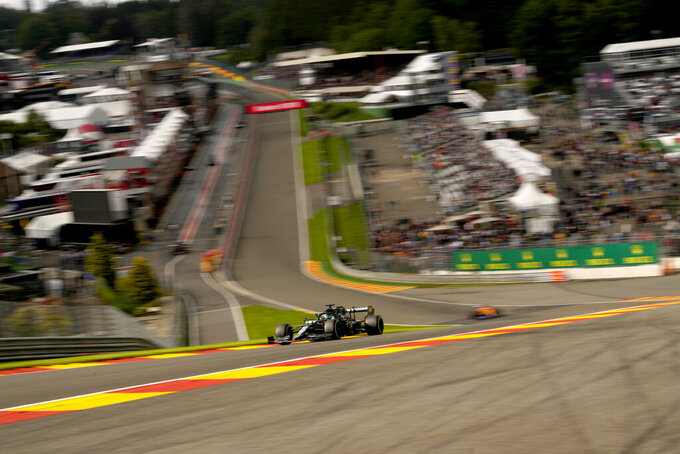 Aston Martin driver Lance Stroll of Canada steers his car during the second practice session prior to the Formula One Grand Prix at the Spa-Francorchamps racetrack in Spa, Belgium, Friday, Aug. 27, 2021. The Belgian Formula One Grand Prix will take place on Sunday. (AP Photo/Francisco Seco)
