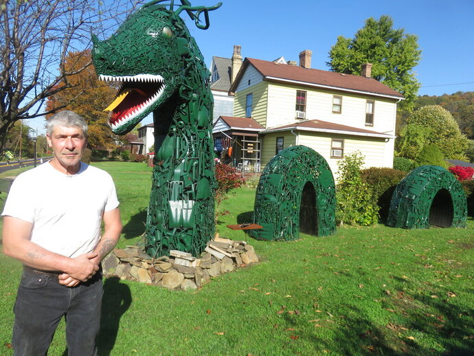In this Oct. 29, 2019, photo Ken Sinsel of New Cumberland, W.Va., poses for a photo in his yard. (Janice Kiaski/Herald-Star via AP)