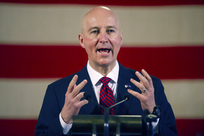 FILE - In this Feb. 26, 2021, file photo, Nebraska Gov. Pete Ricketts speaks during a news conference at the Nebraska State Capitol in Lincoln, Neb. Officials from the Nebraska State Patrol defended their state-funded mission to the U.S.-Mexican border on Thursday, July 22, 2021, arguing that they were answering a call for help from fellow law enforcement officers in Texas amid a surge in illegal border crossings. Patrol officials described the situation in Del Rio, Texas, as a humanitarian crisis and said many locals welcomed them. (Kenneth Ferriera/Lincoln Journal Star via AP, File)