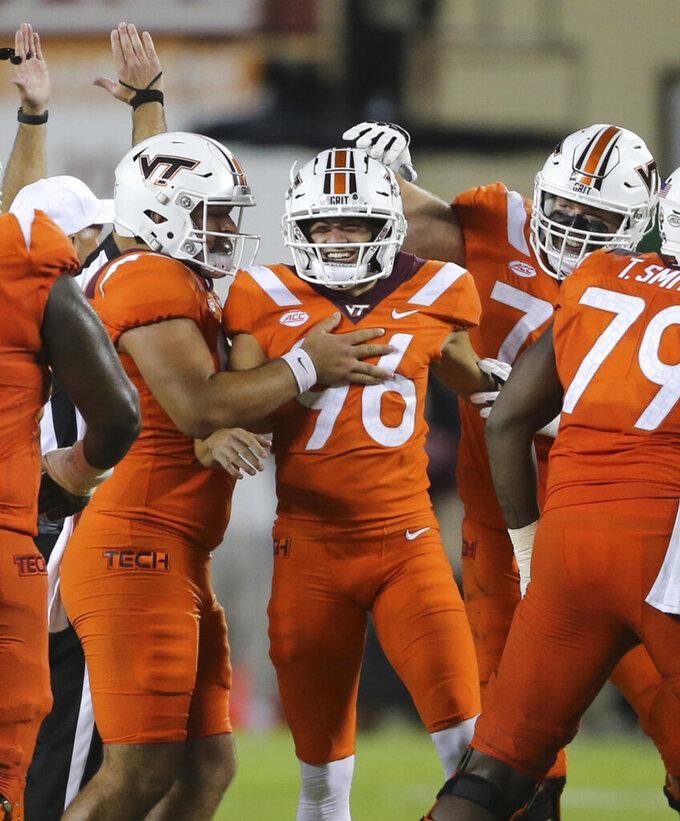 Virginia Tech kicker John Parker Romo (96) celebrates a field goal in the second half against North Carolina during an NCAA college football game Friday, Sept. 3, 2021, in Blacksburg, Va. (Matt Gentry/The Roanoke Times via AP)