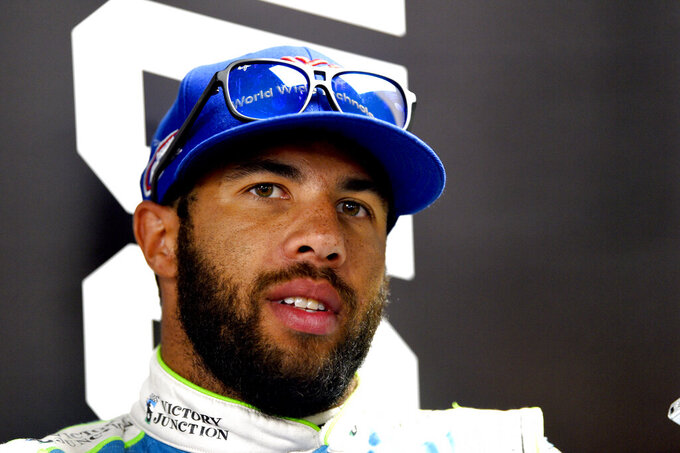 Bubba Wallace answers question during a media availability for Sunday's NASCAR Cup Series auto race, Saturday, July 27, 2019, in Long Pond, Pa. (AP Photo/Derik Hamilton)