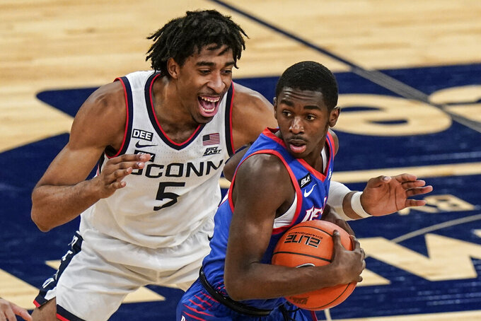 Connecticut's Isaiah Whaley (5) defends against DePaul's Kobe Elvis during the first half of an NCAA college basketball game in the Big East men's tournament Thursday, March 11, 2021, in New York. (AP Photo/Frank Franklin II)