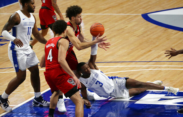 Saint Louis guard Javonte Perkins (3) tries to keep possession of the ball with pressure from North Carolina State guard Devon Daniels (24) during the first half of an NCAA college basketball game, Thursday, Dec. 17, 2020, in St. Louis. (Laurie Skrivan/St. Louis Post-Dispatch via AP)