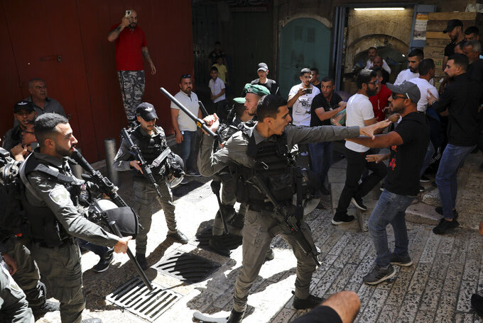 Israeli police and Palestinian protesters clash in Jerusalem's Old City, Tuesday, May 18, 2021. (AP Photo/Mahmoud Illean)