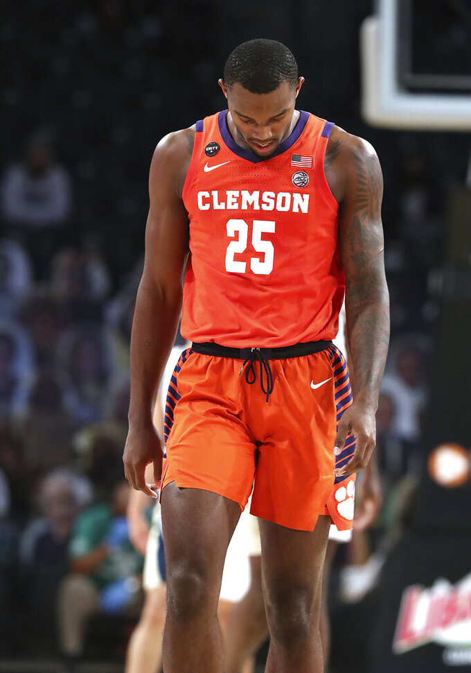 Clemson forward Aamir Simms walks on the court during the team's NCAA college basketball game against Georgia Tech on Wednesday, Jan. 20, 2021, in Atlanta. Georgia Tech won 83-65. (Curtis Compton/Atlanta Journal Constitution via AP, Pool)