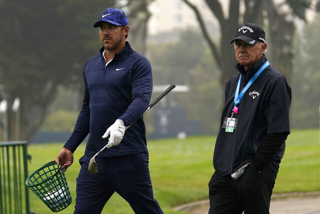 Brooks Koepka, left, walks with instructor Pete Cowen during practice for the PGA Championship golf tournament at TPC Harding Park in San Francisco, Tuesday, Aug. 4, 2020. (AP Photo/Jeff Chiu)