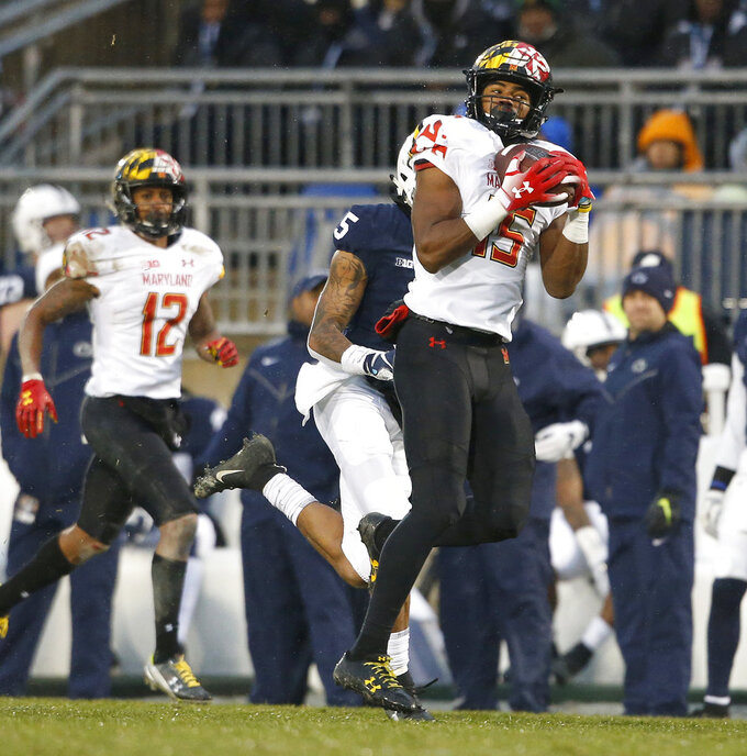 Maryland's Brian Cobbs (15) catches a pass against Penn State during the first half of an NCAA college football game in State College, Pa., Saturday, Nov. 24, 2018. (AP Photo/Chris Knight)