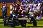 Washington Football Team quarterback Kyle Allen (8) rubs his face as he is carted off the field after injuring his leg in a play against New York Giants in the first half of an NFL football game, Sunday, Nov. 8, 2020, in Landover, Md. (AP Photo/Patrick Semansky)