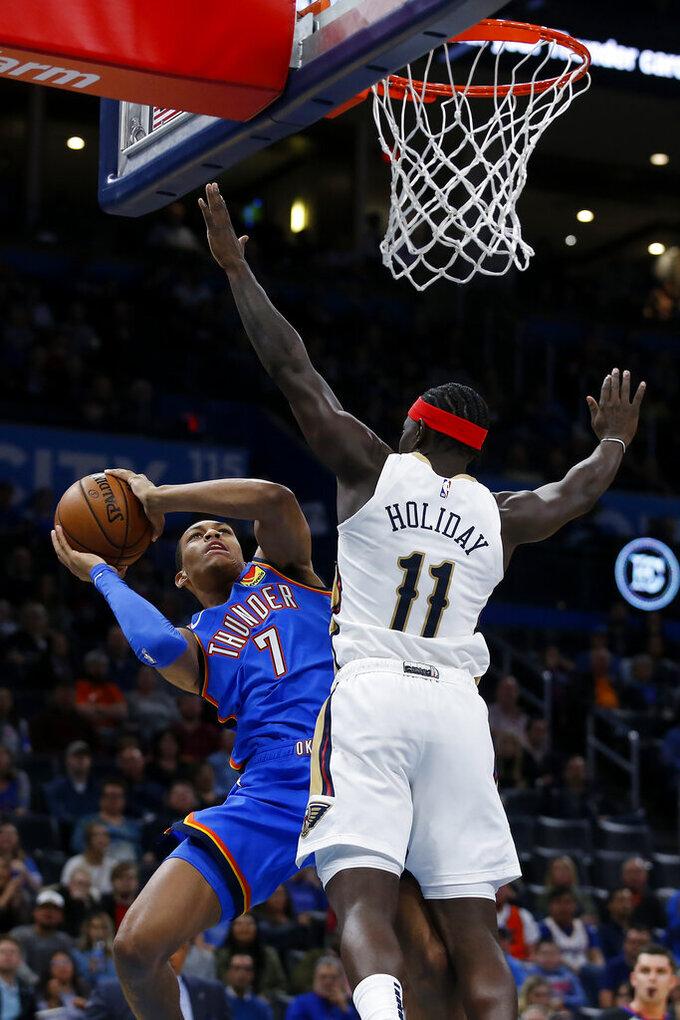 Oklahoma City's Darius Bazley (7) takes a shot against New Orleans' Jrue Holiday (11) during the second half of an NBA basketball game in Oklahoma City, Saturday, Nov. 2, 2019. (AP Photo/Garett Fisbeck)