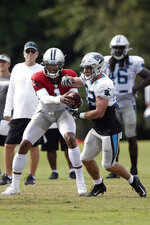 Carolina Panthers quarterback Cam Newton hands off to Christian McCaffrey during an NFL football training camp with the Buffalo Bills in Spartanburg, S.C., Wednesday, Aug. 14, 2019. (AP Photo/Gerry Broome)