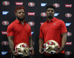 San Francisco 49ers' Kwon Alexander, left, and Dee Ford stand for a photo following an NFL football news conference Thursday, March 14, 2019, in Santa Clara, Calif. (AP Photo/Ben Margot)