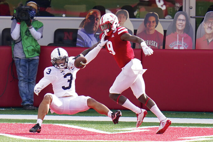 Nebraska safety Marquel Dismuke (9) breaks up a pass intended for Penn State wide receiver Parker Washington (3) in the end zone, during the second half of an NCAA college football game in Lincoln, Neb., Saturday, Nov. 14, 2020. Nebraska won 30-23. (AP Photo/Nati Harnik)