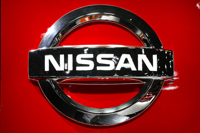 FILE - In this Jan. 14, 2019, file photo, a Nissan logo is shown at the North American International Auto Show in Detroit. Slumping Nissan Motor Co. is offering voluntary separation packages to many of its U.S. workers as it tries to resize itself to match lower sales. Eligible workers will be notified by Friday, Jan. 31, 2020, and would leave later in the year. (AP Photo/Paul Sancya, File)
