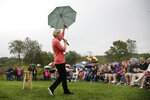 Democratic presidential candidate Sen. Elizabeth Warren, D-Mass., gestures with an umbrella as she speaks at a campaign event, Monday, Sept. 2, 2019, in Hampton Falls, N.H. (AP Photo/Elise Amendola)