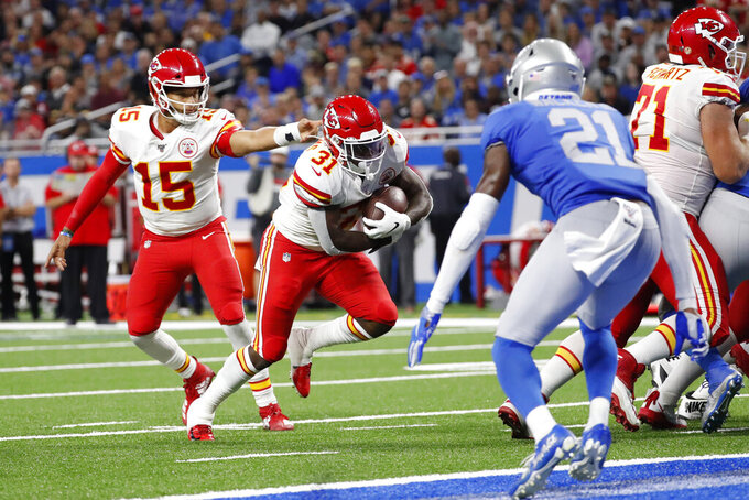 Kansas City Chiefs quarterback Patrick Mahomes (15) hands off to running back Darrel Williams (31) for a 1-yard touchdown rush during the second half of an NFL football game against the Detroit Lions, Sunday, Sept. 29, 2019, in Detroit. (AP Photo/Rick Osentoski)