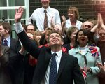 FILE - In this Friday, May 2, 1997 file photo, Britain's new Prime Minister Tony Blair, waves to wellwishers in Downing Street, London. Blair's Labour Party heavily defeated the Conservatives in Britain's General Election to end 18-years of Conservative rule. Blair will be Britain's youngest prime minister this century. Britain is facing the most testing and significant, some would say tortuous, period in its modern history since World War II. The polarized electorate now has a critical choice to make _but it seems unlikely the result, whatever it may be, will heal deep and toxic divisions that could last a generation or more. (AP Photo/Max Nash, file)