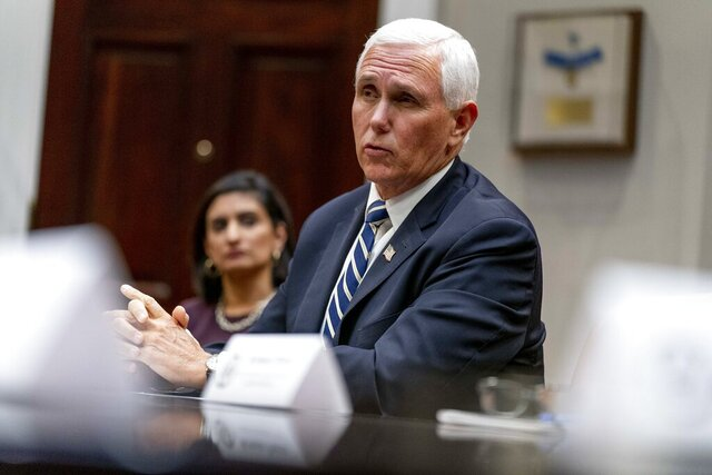 Vice President Mike Pence, accompanied by Administrator of the Centers for Medicare and Medicaid Services Seema Verma, left, participates in a meeting on safety and quality for nursing homes in the Roosevelt Room of the White House, Thursday, Sept. 17, 2020, in Washington. (AP Photo/Andrew Harnik)