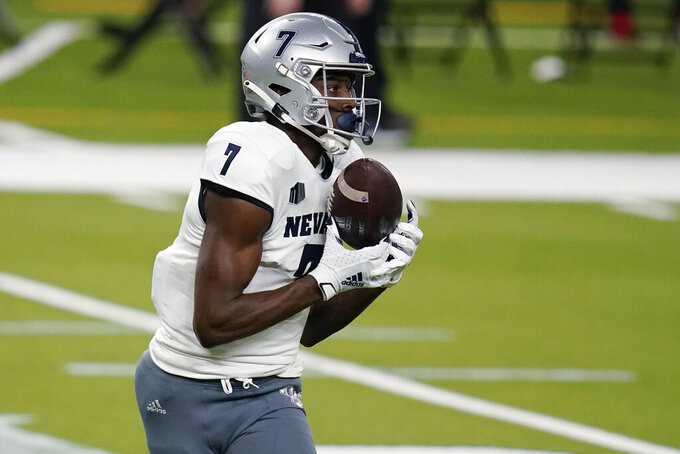 Nevada wide receiver Romeo Doubs (7) catches a pass for a touchdown against UNLV during the first half of an NCAA college football game Saturday, Oct. 31, 2020, in Las Vegas. (AP Photo/John Locher)