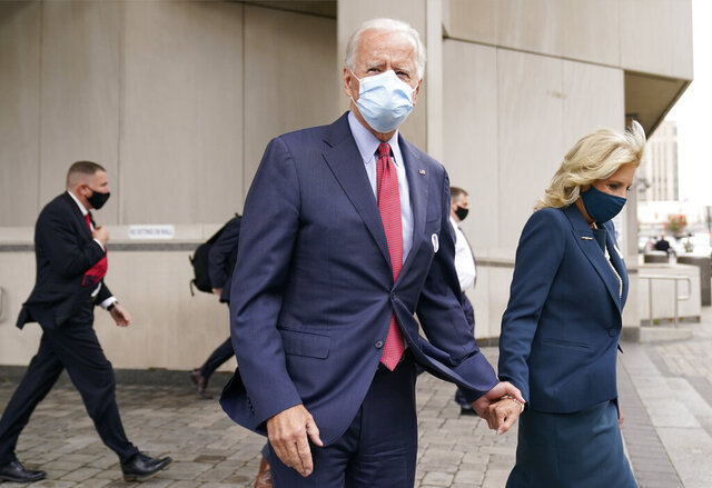Democratic presidential candidate former Vice President Joe Biden and his wife Jill Biden leave after they voted at the Carvel State Office Building, Wednesday, Oct. 28, 2020, in Wilmington, Del. (AP Photo/Andrew Harnik)