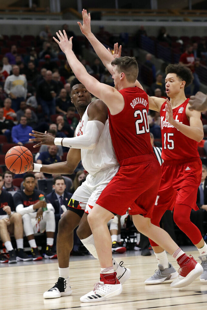 Maryland's Bruno Fernando (23) looks to pass against Nebraska's Tanner Borchardt (20) during the second half of an NCAA college basketball game in the second round of the Big Ten Conference tournament, Thursday, March 14, 2019, in Chicago. (AP Photo/Nam Y. Huh)