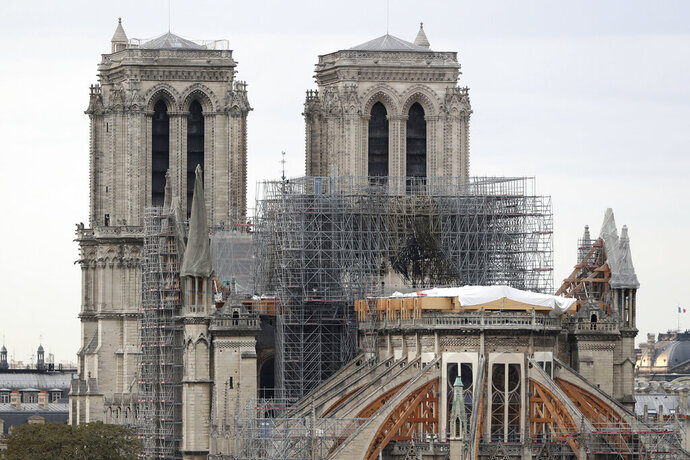 "FILE - In this Monday, Sept. 9, 2019 file photo, the Notre Dame cathedral is pictured in Paris. General Jean-Louis Georgelin who is to oversee reconstruction of Notre Dame Cathedral, devastated by fire in April, got a public reprimand for advising the chief architect for France's historic monuments to ""shut his mouth.""  (AP Photo/Thibault Camus, File)"