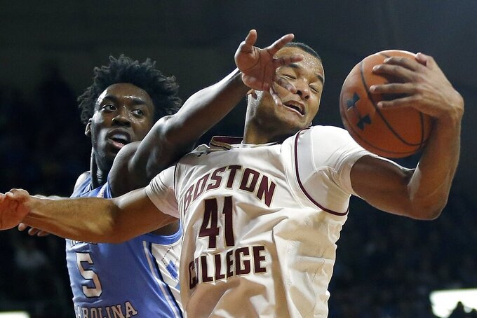 Boston College's Steffon Mitchell (41) grabs a rebound against North Carolina's Nassir Little (5) during the first half of an NCAA college basketball game in Boston, Tuesday, March 5, 2019. (AP Photo/Michael Dwyer)