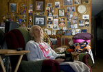 ADVANCE ON THURSDAY, SEPT. 12 FOR USE ANY TIME AFTER 3:01 A.M. SUNDAY SEPT 15 - Harriett Noyes sits in her living room at the Phillips Mobile Home Park near Aspen, Colo., on Wednesday, Aug. 28, 2019. Noyes, who owned the 76-acre park, had a chance to sell it to a developer for $30 million but decided she didn't want her family and friends to be evicted. She instead sold it to Pitkin County for $6.5 million with the promise of upgrades and to keep the community affordable. (AP Photo/Thomas Peipert)