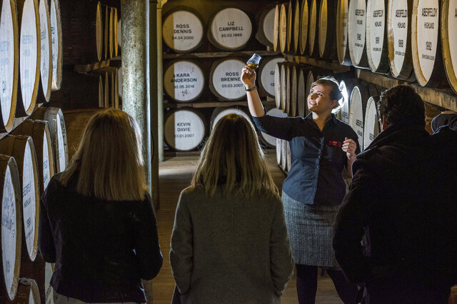 People are guided during a cellar tour of the Dewar's Distillery in Aberfeldy, the Scottish Highlands, in 2018, where they have produced Scotch whisky since 1898, and offer traditional whisky tastings, and a whisky and chocolate tasting tour.  Many people now like to know more about their food and drink and where it comes from, leading to a boom in so-called