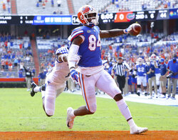 FILE - Florida Gators tight end Kyle Pitts (84) scores a touchdown during an NCAA college football game against Kentucky in Gainesville, Fla., in this Nov. 28, 2020, file photo. Kyle Pitts is arguably the most dynamic playmaker in the NFL draft, a versatile tight end who will try to impress league executives in person during Florida's pro day Wednesday, March 31, 2021.  (Brad McClenny/The Gainesville Sun via AP, File)