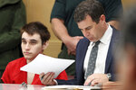 Florida school shooting defendant Nikolas Cruz, left, and defense attorney Gabe Ermine attend a hearing at the Broward County Courthouse in Fort Lauderdale, Fla., Wednesday, Jan. 22, 2020. (Amy Beth Bennett/South Florida Sun-Sentinel via AP, Pool)