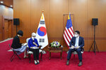 In this photo provided by South Korea Foreign Ministry, U.S. Deputy Secretary of State Wendy Sherman, second from left, talks to journalists as South Korean First Vice Foreign Minister Choi Jong Kun listens after their meeting at the Foreign Ministry in Seoul, South Korea, Friday, July 23, 2021. America's No. 2 diplomat on Friday expressed sympathy for North Koreans facing hardships and food shortages linked to the pandemic, and renewed calls for the North to return to talks over its nuclear program. (South Korea Foreign Ministry via AP)
