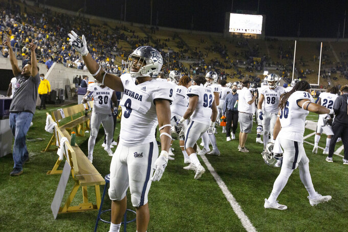 Nevada defensive back Zeke Robbins (9) greets fans in the stands during the fourth quarter of an NCAA college football game against California, Saturday, Sept. 4, 2021, in Berkeley, Calif. Nevada won 22-17. (AP Photo/D. Ross Cameron)