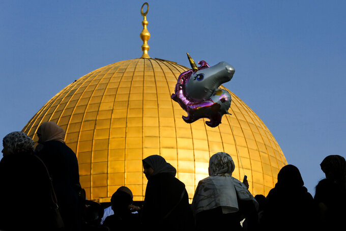 Palestinians gather for Eid al-Adha prayer next to the Dome of the Rock Mosque in the Al Aqsa Mosque compound in Jerusalem's Old City, Tuesday, July 20, 2021. (AP Photo/Mahmoud Illean)